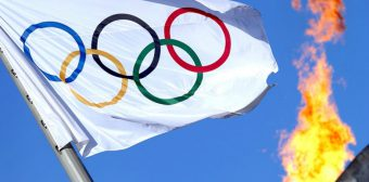 061714-OLY-The-Olympic-flag-flutters-near-the-Cauldron-at-the-Olympic-Park-PI