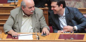 Ο Πρωθυπουργός Αλέξης Τσίπρας (Δ) και ο Υπουργός Εσωτερικών - Διοίκησης Ανασυγκρότησης Νίκος Βούτσης (Δ) συνομιλούν στην ολομέλεια της Βουλής, Πέμπτη 9 Ιουλίου 2015.Πραγματοποιήθηκε στην ολομέλεια της Βουλής η ονομαστική ψηφοφορία επί άρθρων και ψήφιση στο σύνολο του σχεδίου νόμου: «Τροποποίηση διατάξεων Κώδικα Ελληνικής Ιθαγένειας - Τροποποίηση του ν. 4251/2014 για την προσαρμογή της ελληνικής νομοθεσίας στις Οδηγίες του Ευρωπαϊκού Κοινοβουλίου και του Συμβουλίου 2011/98/ΕΕ σχετικά με ενιαία διαδικασία υποβολής αίτησης για τη χορήγηση στους πολίτες τρίτων χωρών ενιαίας άδειας διαμονής και εργασίας στην επικράτεια κράτους - μέλους και σχετικά με κοινό σύνολο δικαιωμάτων για τους εργαζομένους από τρίτες χώρες που διαμένουν νομίμως σε κράτος - μέλος και 2014/36/ΕΕ σχετικά με τις προϋποθέσεις εισόδου και διαμονής πολιτών τρίτων χωρών με σκοπό την εποχιακή εργασία και άλλες διατάξεις». ΑΠΕ-ΜΠΕ/ΑΠΕ-ΜΠΕ/Παντελής Σαίτας